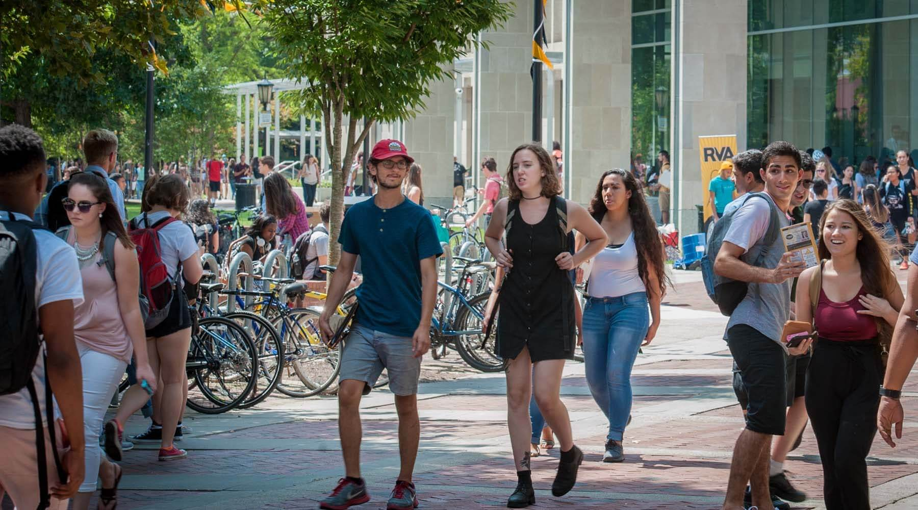 Students walk in front of VCU's Cabell Library